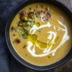 creamy roasted butternut squash soup with pepitas, crema and olive oil