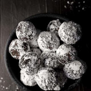 bowl of powdered sugar covered chocolate truffles