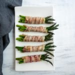 bacon wrapped asparagus spears on a plate