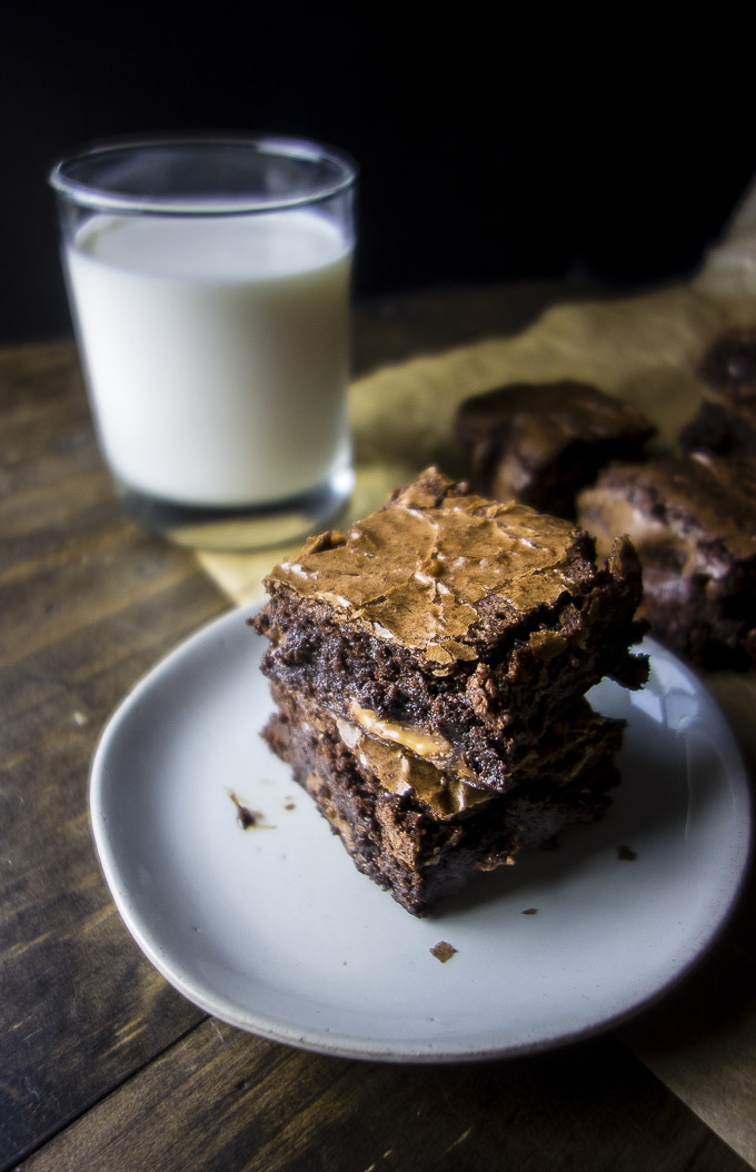 stack of rolo brownie on plate with glass of milk