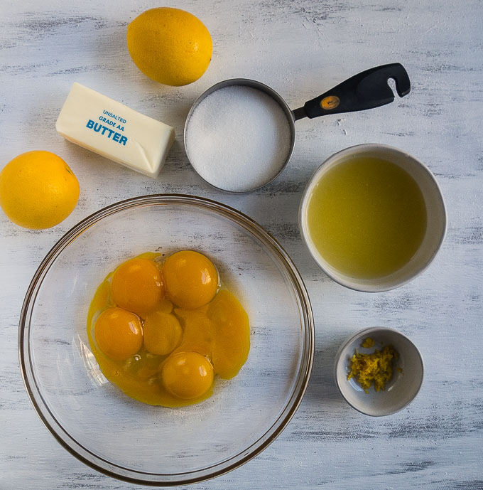 egg yolks, lemon juice, sugar, lemons and butter