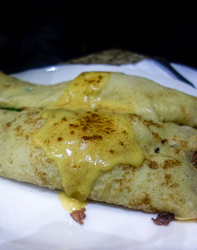crepes with hollandaise sauce over top