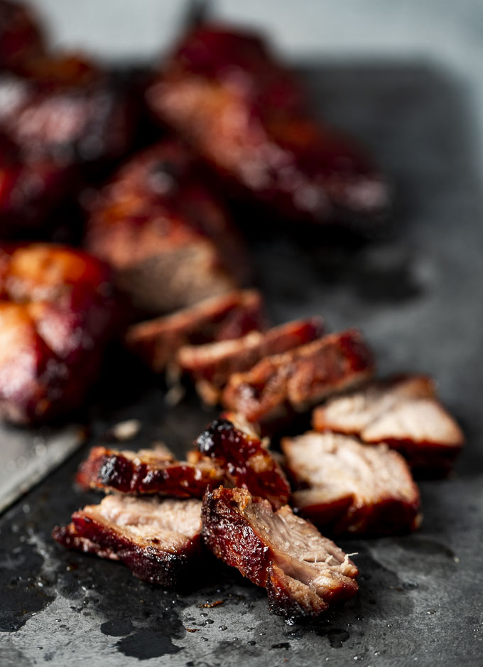 pieces of char siu (bbq pork) on a platter