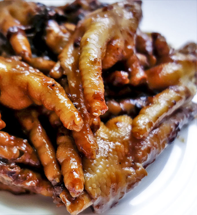 close up of braised chicken feet with sauce