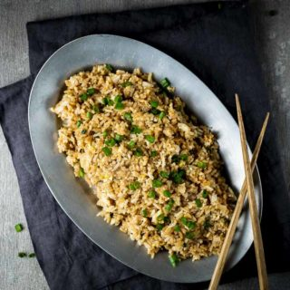 plate of fried rice with chopsticks