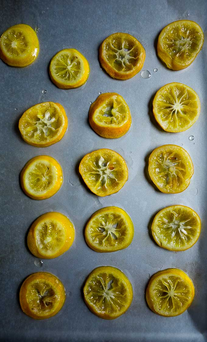 candied lemon slices on a baking sheet