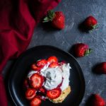 biscuit topped with whipped cream and strawberries, homemade strawberry shortcake food photography
