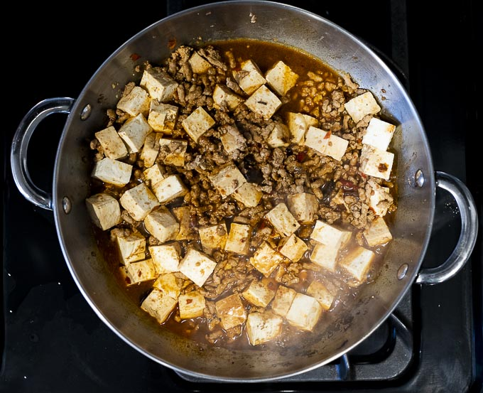 mapo tofu being cooked in a skillet