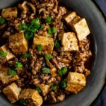 bowl of tofu and ground pork in a brown sauce