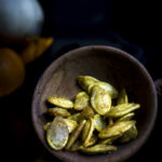 curry roasted pumpkin seeds in a bowl