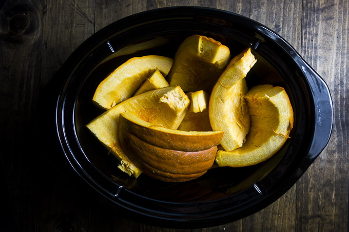 cut up pumpkin in a slow cooker