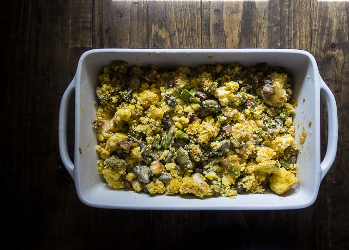 cornbread oyster stuffing in a baking dish before being cooked