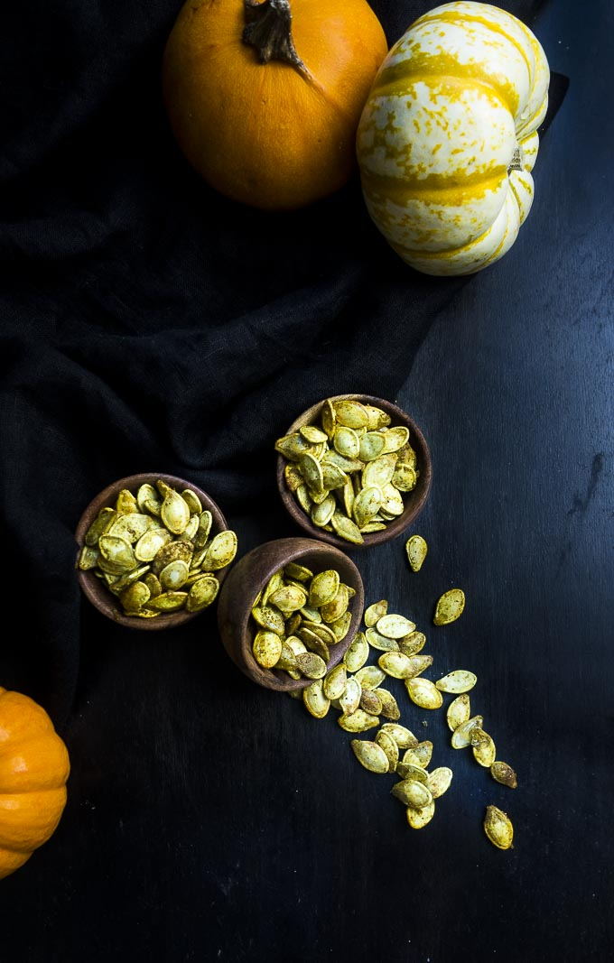 fresh pumpkin seeds roasted and in bowls