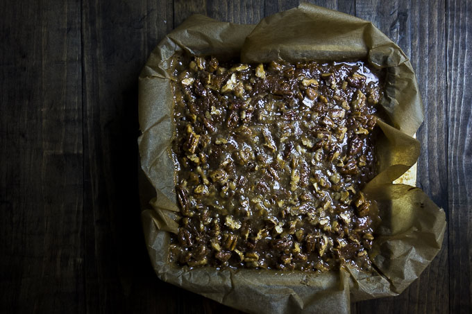 pumpkin pie pecan bars in a baking pan