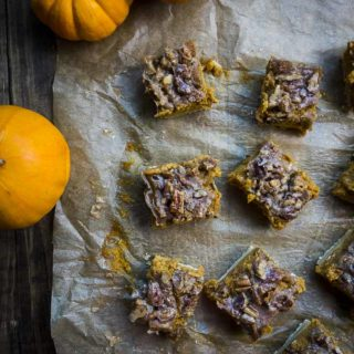 sliced pumpkin pecan bars on parchment paper