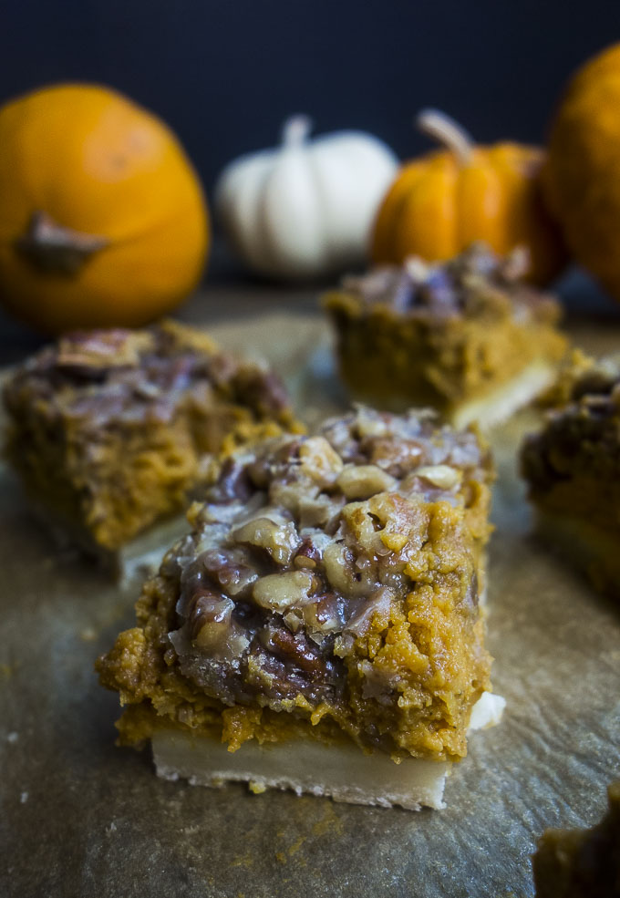 close up of pumpkin pie bar with pecan topping