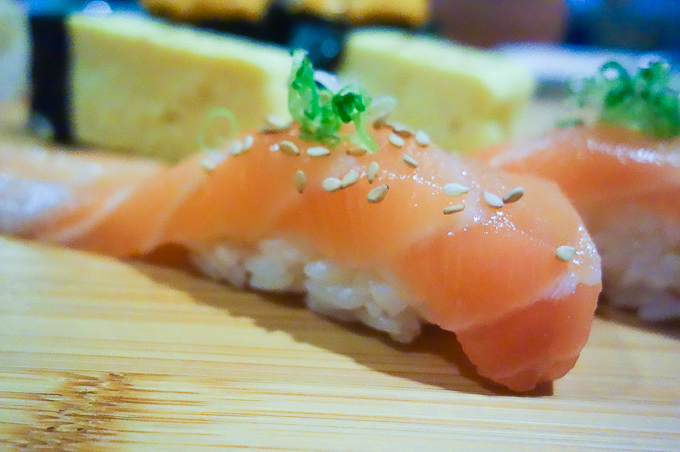 best sushi in san diego, salmon belly served on rice with garnish
