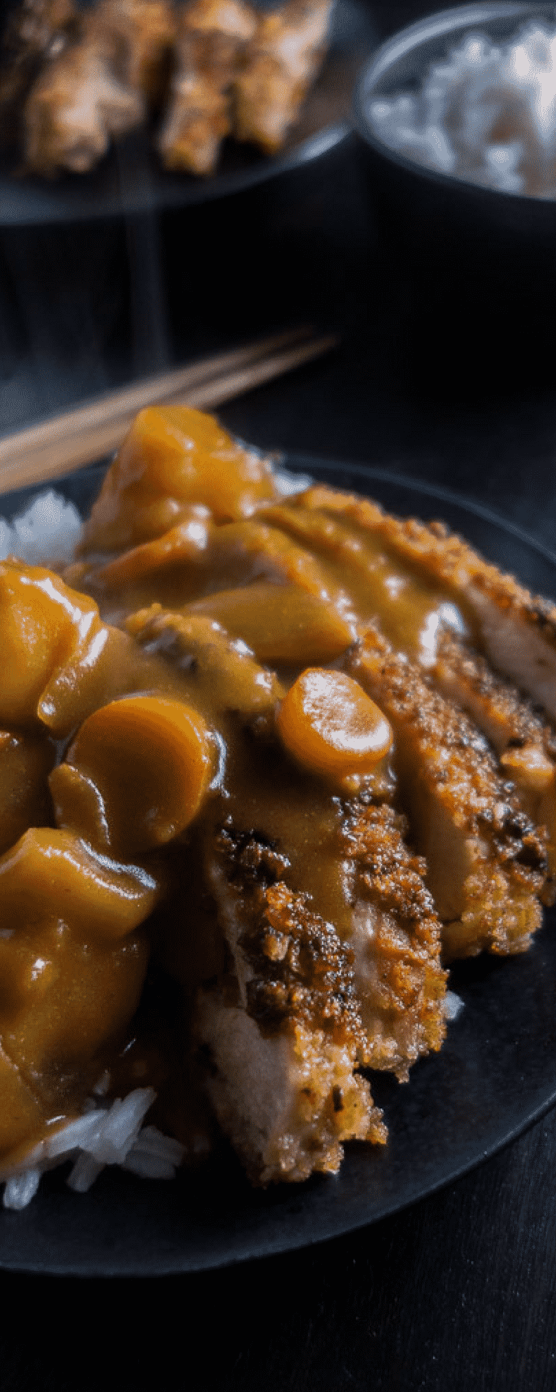 An awesome winter comfort food, this easy Chicken Katsu Curry Don is quick, easy and packed full of the most amazing flavors! Perfect to curl up with on a cold day!japanese katsu curry | easy japanese curry | easy katsu | japanese food | japanese comfort food | japanese chicken cutlet | japanese fried chicken | japanese curry sauce | the best curry recipe | sweet curry