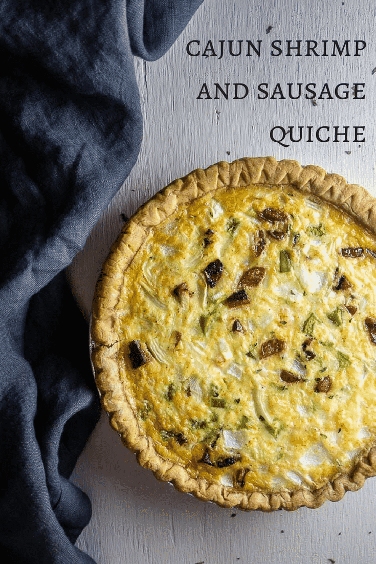 This Cajun shrimp and sausage quiche is everything you love about quiche with a rich egg and cream filling, fresh veggies and shrimp, and spicy andouille sausage!southern quiche | easy quiche recipes | best quiche recipes | pie crust | creole quiche | sausage quiche | seafood quiche | mardi gras recipes | cajun shrimp quiche | louisiana quiche | quick quiche recipes | make ahead quiche