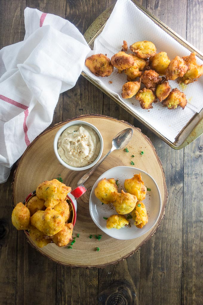 jalapeno cheese hush puppies in a cup served with remoulade sauce