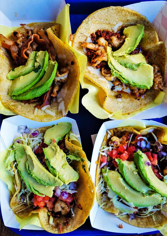 4 tacos on a table with avocado, tacos in downtown san diego