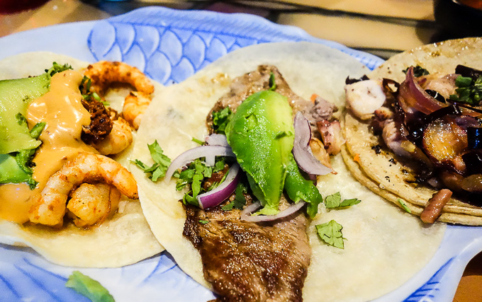 3 tacos on a table with avocado, tacos in downtown san diego