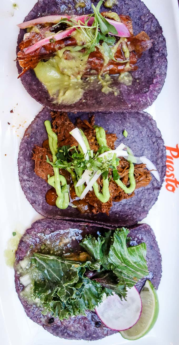 3 tacos on a table with blue corn tortillas, tacos in downtown san diego