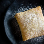 banana nutella puff pastry on a plate with powdered sugar
