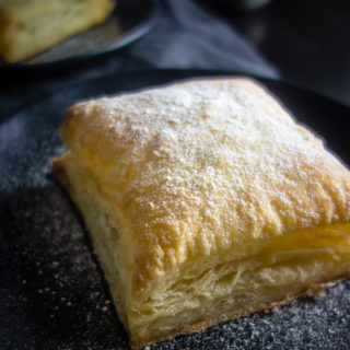 close up of banana nutella puff pastry with powdered sugar