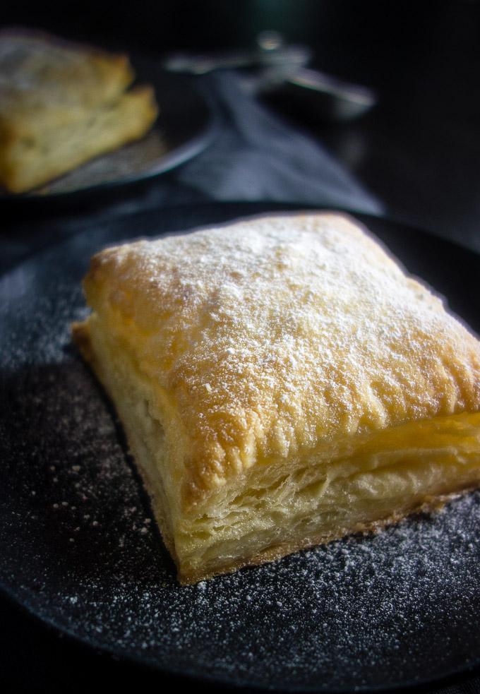 close up of banana nutella puff pastry with powdered sugar