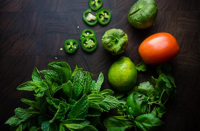 fresh herbs, tomato, jalapenos, tomatillos for vietnamese salsa