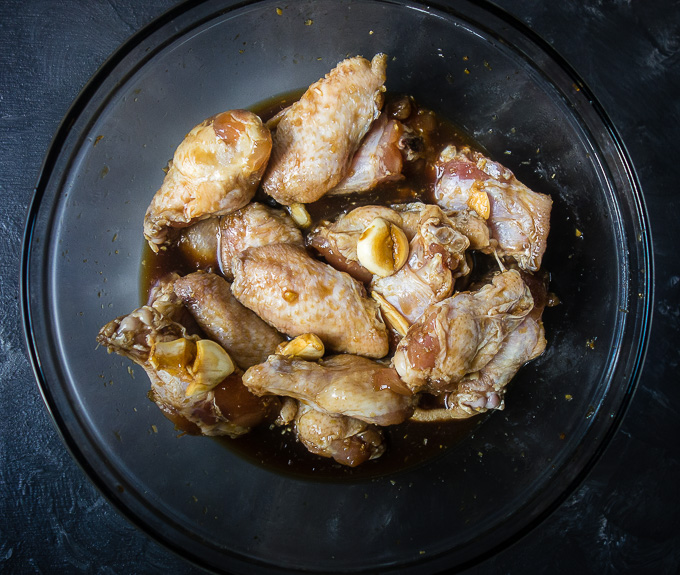 chicken wings in marinade with garlic