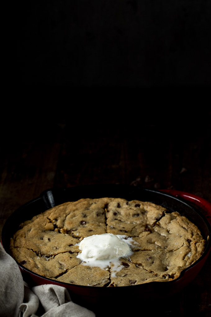 chocolate chip cookie in a skillet with ice cream