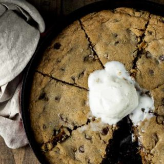 cookie cooked in a skillet topped with ice cream