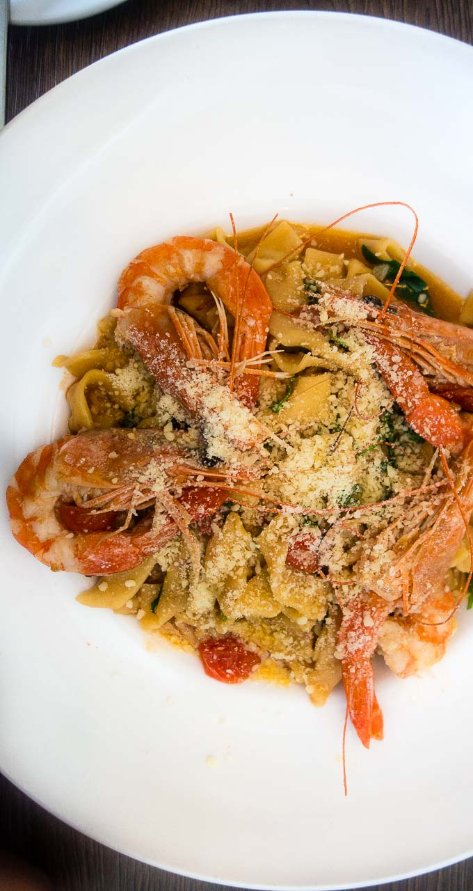 pasta with fresh prawns, parmesan cheese and tomatoes on plate, civico 1845