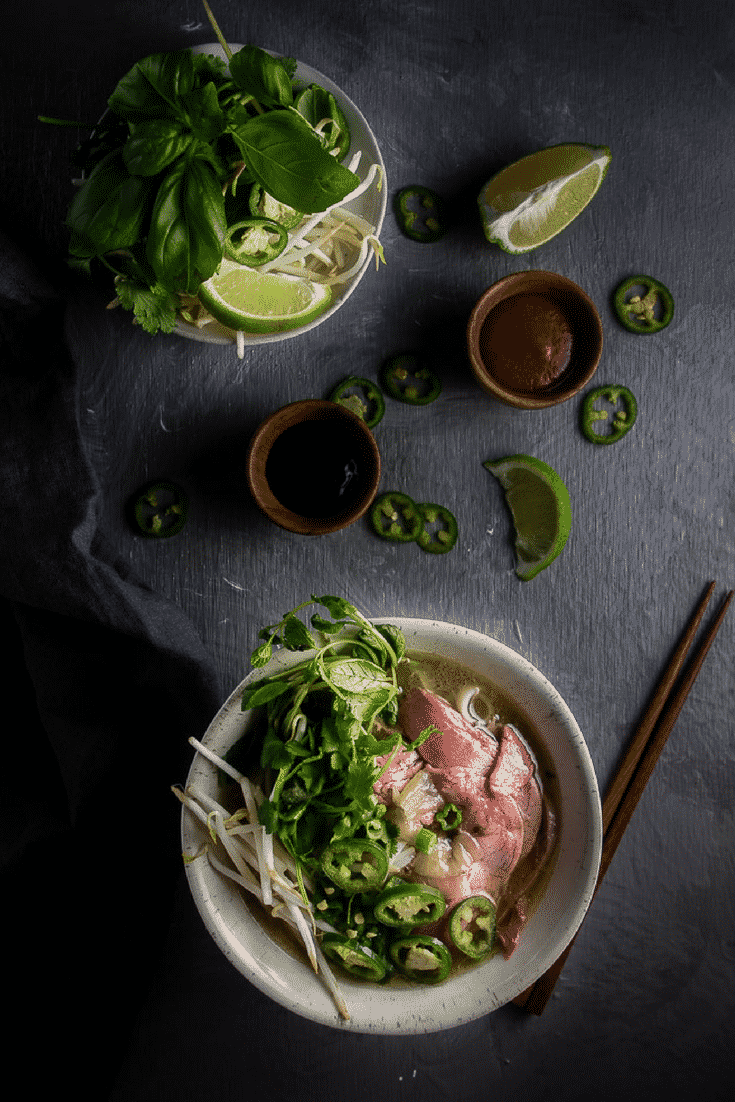 This easy Instant Pot beef pho recipe is incredibly easy to make, only requiring a few minutes of hands-on cooking time to get an intensely rich, flavorful broth!Instant Pot Recipes | vietnamese pho noodles soup | beef pho soup | beef noodle soup | vietnamese recipes | vietnamese soup | quick beef pho | easy pho | brisket pho | homemade pho | beef pho broth | how to make pho | vietnamese beef pho