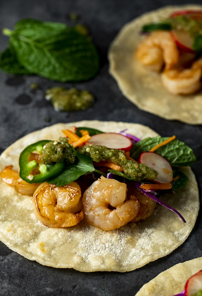 shrimp, herbs, jalapeno and vegetables on a corn tortilla