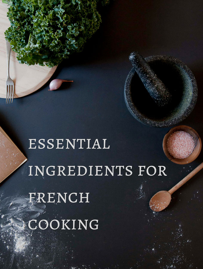 cooking ingredients on a background with wording, essential ingredients for french cooking