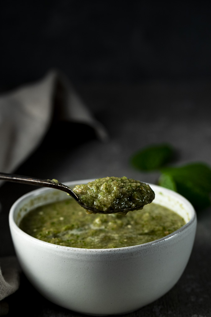 side view of a spoonful of green sauce