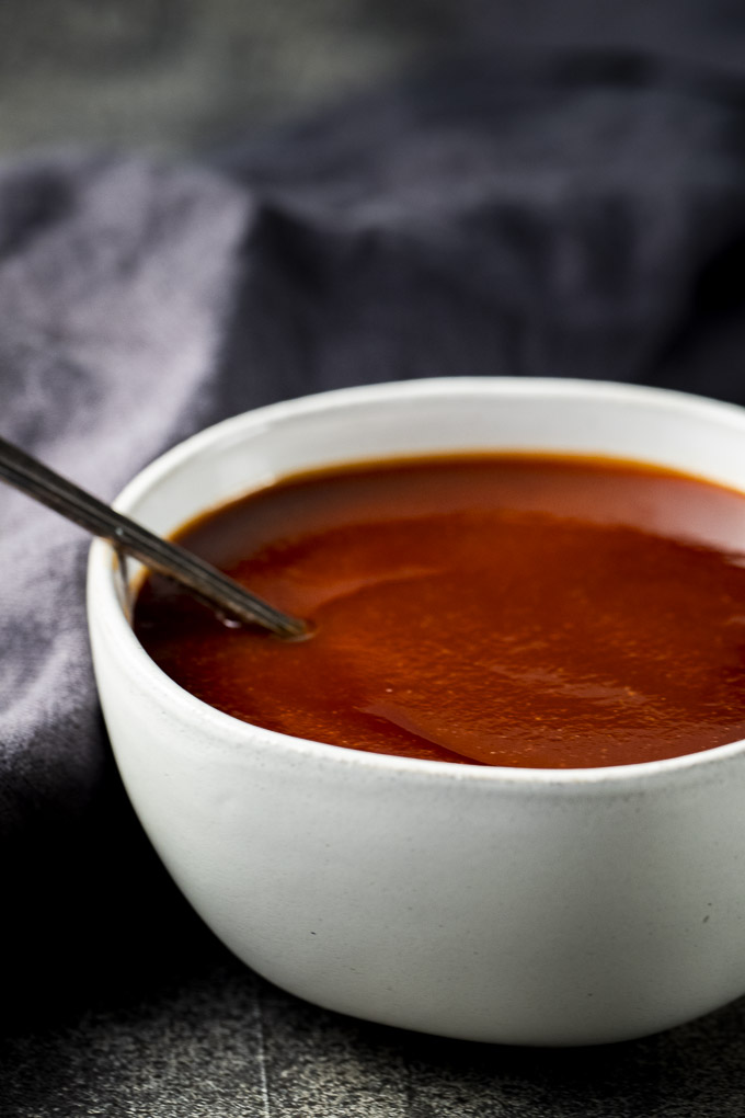 bowl of barbecue sauce with a spoon