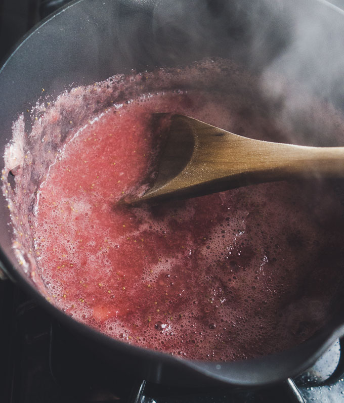 strawberry sauce being cooked on the stove