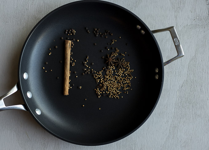 whole spices toasted in a skillet