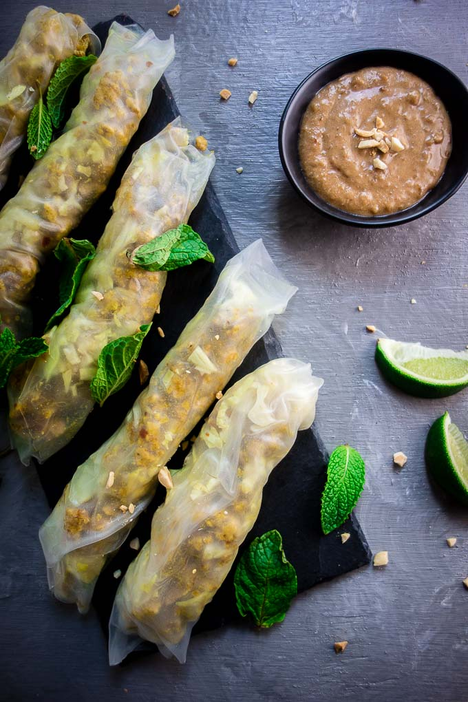 lemongrass chicken spring rolls with peanut sauce on plate