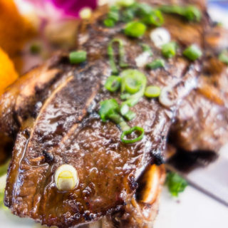 close up of marinated kalbi ribs at matua's sushi bar and islander grill