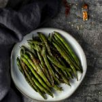 green beans with chilies on a plate