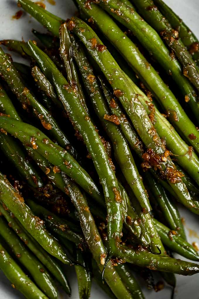 close up of green beans with chilies and spices