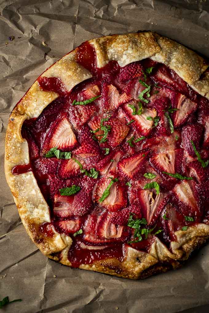 whole strawberry galette with chopped mint on top