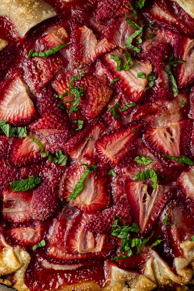 baked sliced strawberries with chopped mint