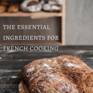 background of baked bread with wording essential ingredients for french cooking