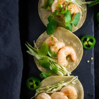 3 vietnamese shrimp street tacos with fresh herbs